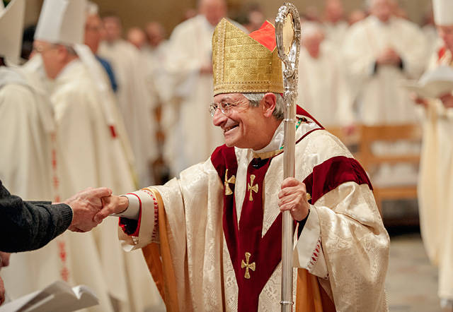Salvatore R. Matano greets well-wishers as he processes out of his installation Mass at Rochester's Sacred Heart Cathedral. (File photo)