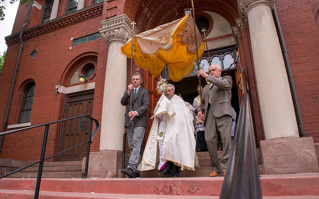 Bishop Salvatore R. Matano exits Rochester's St. Stanislaus Kostka Church to begin a eucharistic procession around the church grounds after the June 3 closing Mass for the diocesan Year of the Eucharist. (Courier photo by Jeff Witherow)