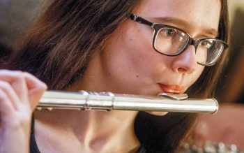 <p>Fifteen-year-old Rebecca Shannon plays the flute during the confirmation Mass at Our Lady of Lourdes Church in Elmira May 25. Rebecca and several other teens from the Southern Tier recently received diocesan Music Ministry Recognition Awards for participation in music ministry at their parishes.  Photo by Rick Bacmanski </p>