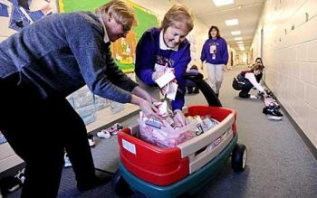 Faculty and staff at Christ the King School collect toiletries for the Red Cross and distribute candy Dec. 4.
