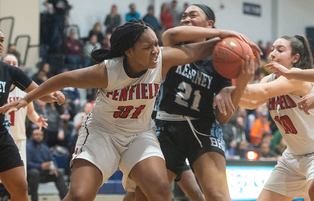 Bishop Kearney's Saniaa Wilson (21) ties up with Penfield's Nyara Simmons (31) and Jessica Rinere (10) for the ball in the second half of the Section 5 Class AA championship in Victor March 2. Bishop Kearney won 58-54. (Courier photo by John Haeger)