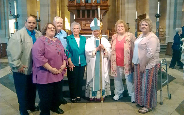 Eugene and Shirley VanDeWalle (center) with son-in-law and daughter Ron and Kathy Maiorani (left), Bishop Salvatore R. Matano and daughters Laurie Gavigan and Karen Ambroz (right) at the Marriage Jubilee Mass at Sacred Heart Cathedral May 19. (Photo courtesy of Laurie Gavigan)