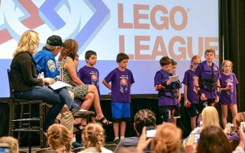 The Eight Magneteers present their innovation project, Magnetic Dodgeball, to three experts and the other robotics teams at FIRST LEGO League Global Innovation Award in San Jose, Calif., July 2. (Photo courtesy of Ed Rivera)