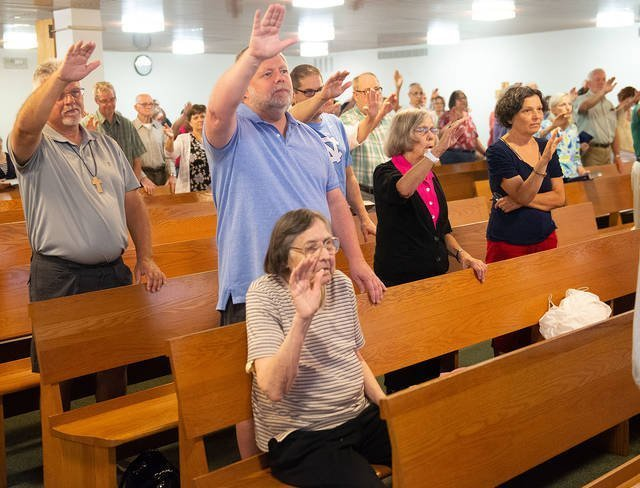 Parishioners pray at Good Shepherd in Henrietta Aug. 25. The church campus was sold to the Rush-Henrietta School District in July, and the church's operations will shift to Henrietta's Guardian Angels Church by the end of November.