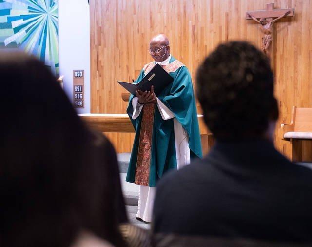 "Father Malachy ""Eloo"" Nwosu, parochial vicar for St. Marianne Cope Parish, celebrates Mass at at Good Shepherd Church in Henrietta Aug. 25."