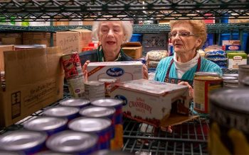 Elmira Community Kitchen director Kathy Dubel (left) and volunteer Mary Kay Brown work in the pantry at the kitchen Nov. 8. (Courier photo by Jeff Witherow)