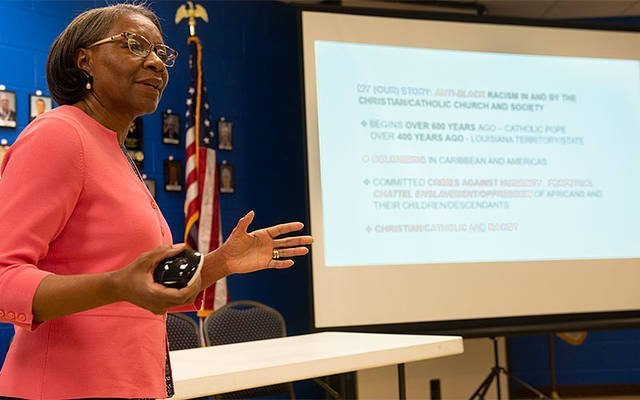 Attorney Judy Toyer gave a presentation Oct. 23 at Church of the Assumption in Fairport as part of a six-session series on racism. (Courier photo by John Haeger)