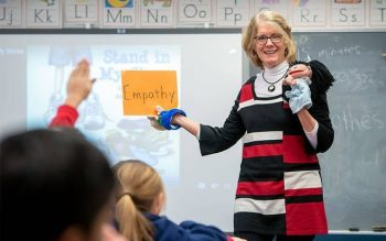 Ginny Riedman, the school counselor at St. Lawrence School in Greece, leads the second-grade class in a lesson on empathy Dec. 16. (Courier photo by Jeff Witherow)