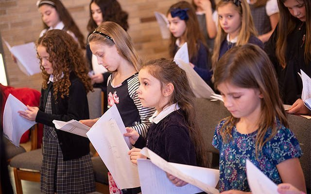 Students from St. Joseph School in Penfield take part in a Catholic Schools Week Mass Jan. 26 at St. Joseph Church. As part of the school's focus on social and emotional learning, students are encouraged to take on liturgical roles during school Masses. (Courier photo by John Haeger)