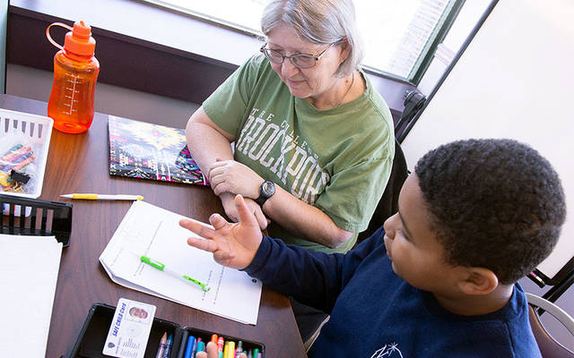 Nazir White works on math with tutor Cathy Appelby at the Notre Dame Learning Center in Rochester Oct. 10. (Courier photo by Jeff Witherow)