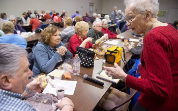 Sam Galusha, Joanne Galusha and Elaine Giancuriso talk with Dottie Denninger during a Seniors on the Move gathering Feb. 4 at St. Mark Church in Greece. (Courier photo by John Haeger)