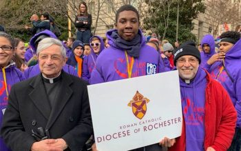Skyler Harmon stands with Bishop Salvatore R. Matano and Father Anthony Mugavero during the March for Life in Washington, D.C., Jan. 24. (Photo courtesy of Elizabeth MacKinnon)