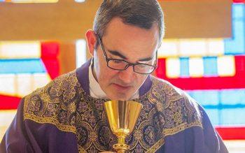Father William Coffas celebrates the Eucharist March 11, 2015. (File photo)