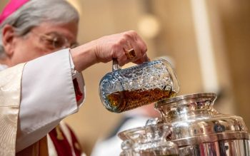 Bishop Salvatore R. Matano pours balsam into oil for the Sacred Chrism. (Courier photo by Jeff Witherow)