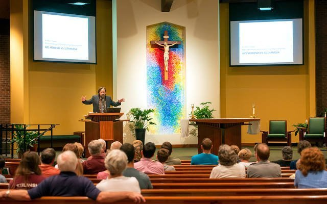 Peter Colosi gives a presentation on the euthanasia debate Aug. 3 at St. John of Rochester Church in Fairport. Colosi is an assistant professor of philosophy at Salve Regina University in Newport, R.I.  Courier photos by Jeff Witherow