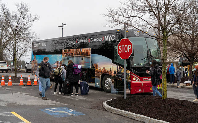 Local medical personnel board a bus headed to New York City April 9 to help area hospitals cope with the rising COVID-19 crisis. (Photo courtesy of Cayuga Medical Center)