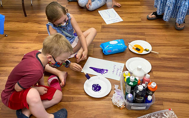 Children in the faith-formation program at St. John of Rochester Parish in Fairport work on craft projects Aug. 5. (Photo courtesy of Pam Sikora)