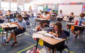 Fifth-grade students at St. Pius Tenth School in Chili complete work in their classroom Sept. 18.