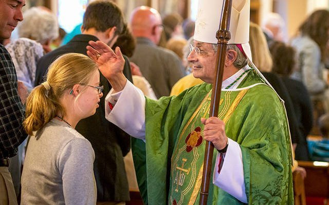 Bishop Salvatore R. Matano blesses Teresa Flugel at the end of the Oct. 1, 2017, diocesan Respect Life Sunday Mass at Our Lady of Victory/St. Joseph Church in Rochester. (Courier file photo)