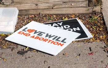 Pro-life signs are seen during a demonstration in Rochester Sept. 23. (Courier photo by Jeff Witherow)