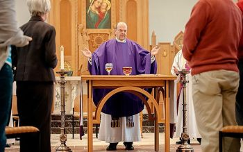 Syracuse Bishop Robert J. Cunningham celebrates Mass at the Pastoral Center chapel Dec. 13. Bishop Cunningham served as apostolic administrator for the Diocese of Rochester for 15 months. (Courier photo by Mike Crupi)