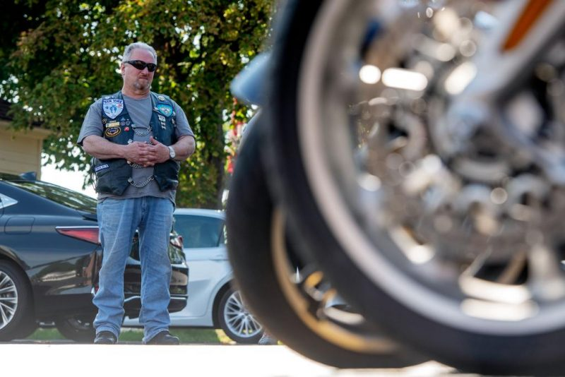 Joe Amorese stands near his motorcycle during the blessing.