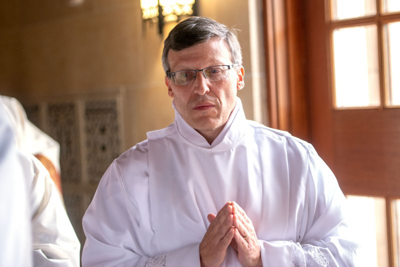 Brian Mizzoni processes into Sacred Heart Cathedral in Rochester for the Aug. 21 deacon ordination Mass.