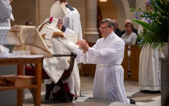 Brian Mizzoni pledges his obedience to Bishop Matano and his successors.