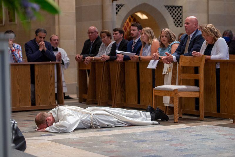 Aaron Kelly prostrates himself before the altar.