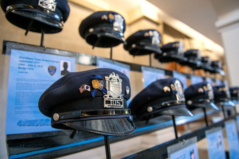 A memorial recognizing fallen officers is displayed during the Mass.