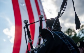 A Keystone Club Pipes and Drums member is seen following the Mass.