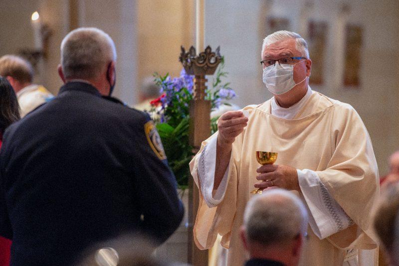 Deacon Edward Giblin distributes Communion.