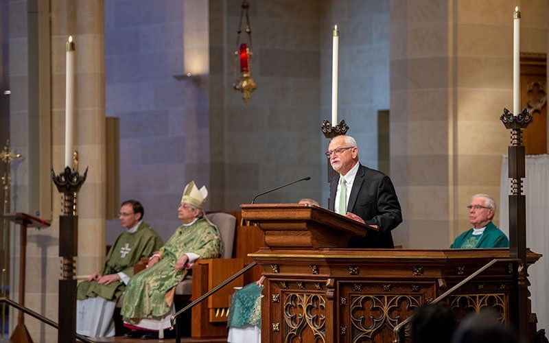 Bernard Grizard, diocesan director of the Office of Pastoral Services, proclaims the second reading during the Oct. 10 Mass at Rochester's Sacred Heart Cathedral that opened the XVI Ordinary General Assembly of the Synod of Bishops. (Courier photo by Jeff Witherow)