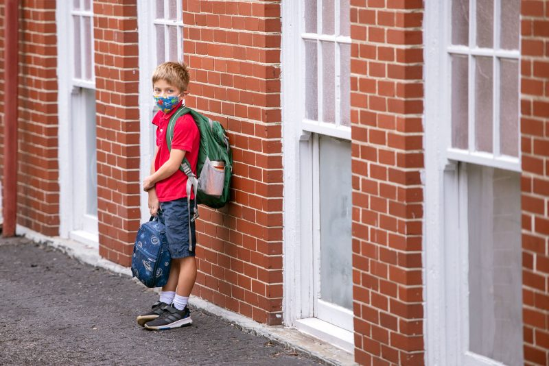 St. Agnes School student Giuseppe Mennucci waits outside the school Sept. 8.