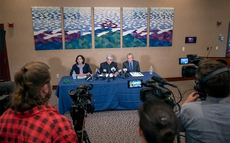 Bishop Salvatore R. Matano (center) speaks to the media at the diocesan Pastoral Center in Gates during a Sept. 12 press conference regarding the diocese's Chapter 11 bankruptcy filing earlier that day. (Courier photo by Jeff Witherow)