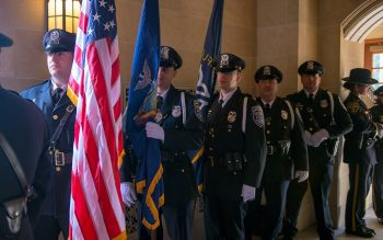 Officers prepare to process into Sacred Heart Cathedral.