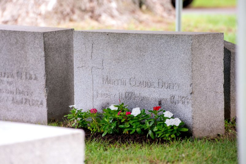 A grave with flowers.