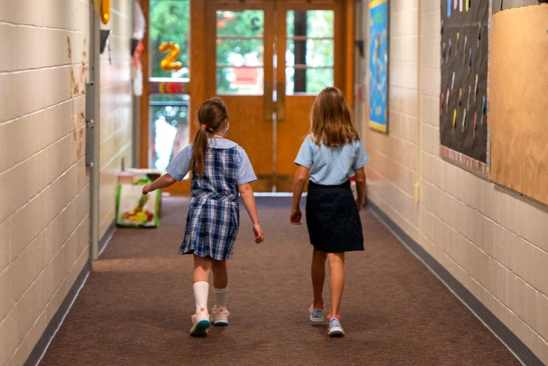 St. Kateri School students walk back to their classrooms Sept. 8.