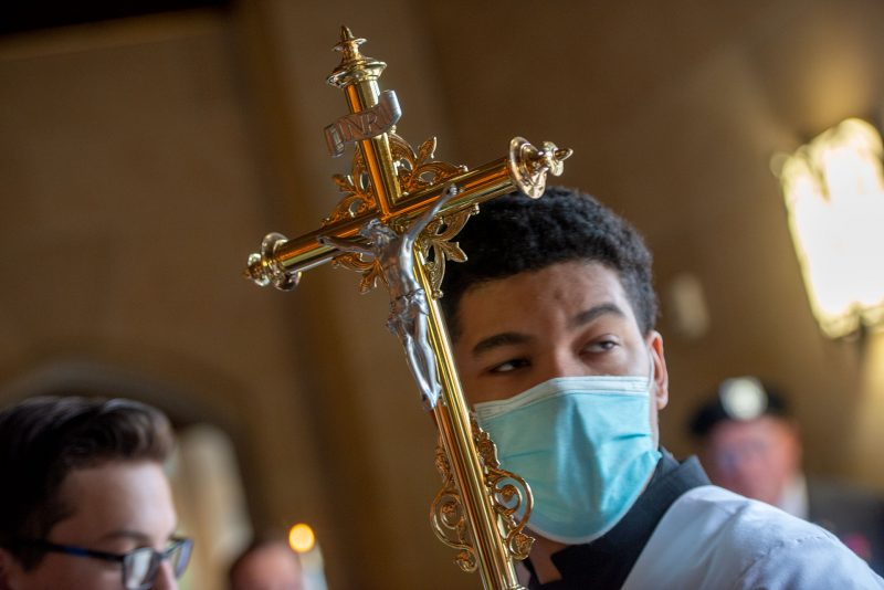 Cross bearer Paul Conley waits to process into the cathedral at the start of the Respect Life Sunday Mass.