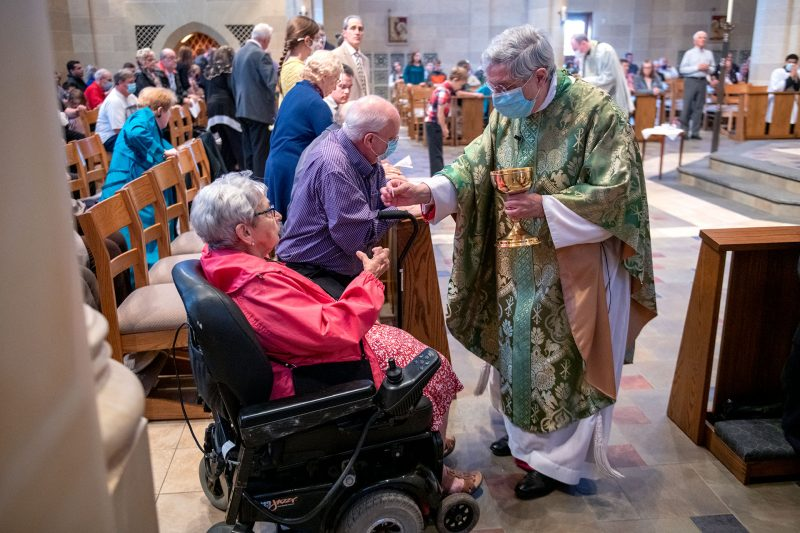 Barb Kristan receives Communion from Bishop Matano.