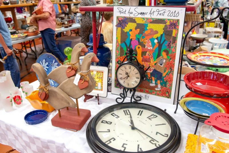 A table displays household items for sale.