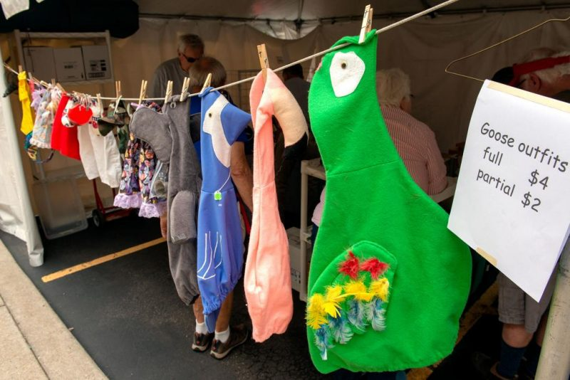Kids' costumes hang on a clothesline.