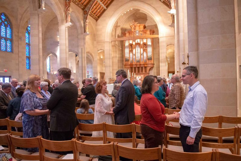 Couples stand during the renewal of vows at the 2019 Marriage Recognition Mass.
