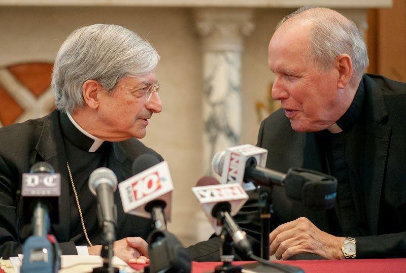 Bishop Salvatore R. Matano speaks to Bishop Emeritus Matthew H. Clark during a Nov. 6, 2013, press conference introducing Bishop Matano as the ninth bishop of Rochester.
