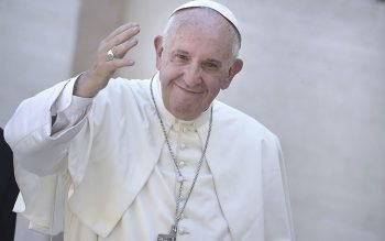 Pope Francis waves after the canonization Mass for Mother Teresa in front of 120,000 faithful in St. Peter's Square at the Vatican on September 4, 2016.