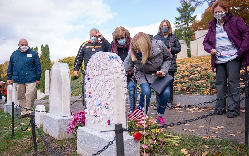 """Visitors place """"I voted"""" stickers on the headstone of Susan B. Anthony at Mount Hope Cemetery in Rochester, NY Oct. 28."""