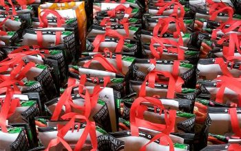 Bags containing Christmas food items for people in need are lined up in the rectory garage of Holy Cross Church in Rochester, awaiting delivery on Dec. 16 by volunteers. (Courier photo by Mike Latona)
